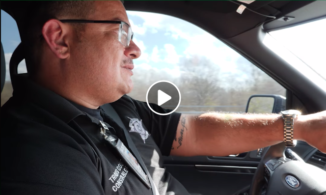 Never Quit Service Award winner George Morales drives his car.